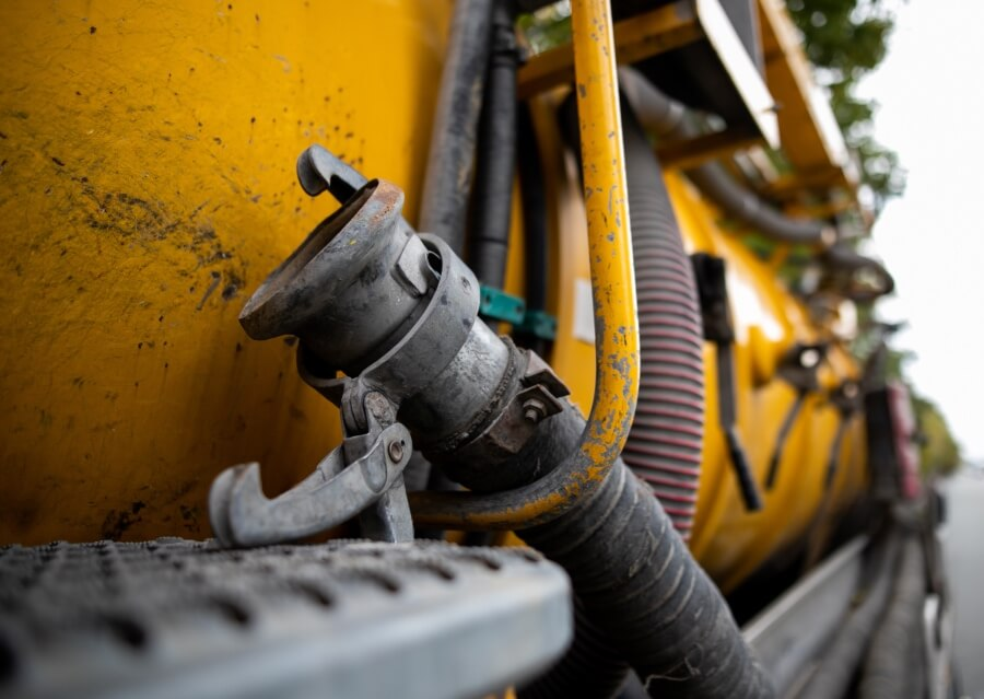 Hose on septic truck for tank pumping